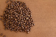 Coffee beans on grung wooden board Royalty Free Stock Images