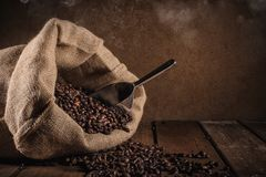 Coffee beans on grunge background stock photos