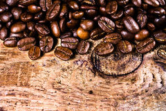 Coffee beans on grunge old wooden background. Coffee concept. Royalty Free Stock Image