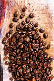 Coffee beans on grunge old wooden background. Coffee concept. To Stock Image
