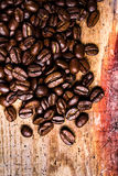 Coffee beans on grunge old wooden background. Coffee concept. To Stock Photography