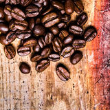 Coffee beans on grunge old wooden background. Coffee concept. To Stock Images