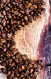 Coffee beans on grunge old wooden background. Coffee concept. Stock Images