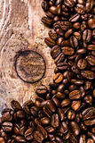 Coffee beans on grunge old wooden background macro. Coffee conce Royalty Free Stock Photo