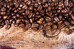 Coffee beans on grunge old wooden background macro. Coffee conce Royalty Free Stock Photography