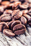 Coffee beans  on grunge wooden background. Royalty Free Stock Images