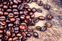 Coffee beans on a grunge wooden background close Royalty Free Stock Photography