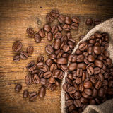 Coffee beans on grunge wooden background Stock Image