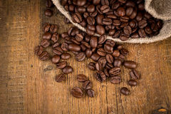 Coffee beans on grunge wooden background Royalty Free Stock Images