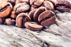 Coffee beans  on grunge wooden background. Stock Photos
