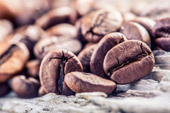 Coffee beans  on grunge wooden background. Royalty Free Stock Photo