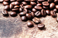 Coffee beans on grunge wooden background up Stock Photography