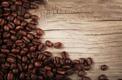 Coffee beans on grunge wooden background Stock Photo