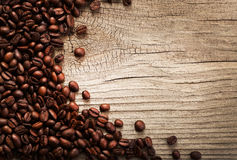 Coffee beans on grunge wooden background Royalty Free Stock Photo
