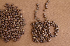 Coffee beans on grunge wooden board Stock Images