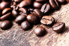 Coffee beans on grunge wooden table top view image, Royalty Free Stock Photos