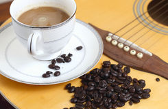 Coffee beans. On a guitar Stock Photos