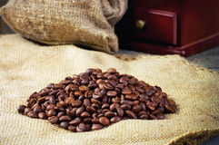 Coffee beans, hand grinder on sacking in vintage grunge style Royalty Free Stock Photography