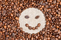 Coffee beans happy smile on burlap Stock Photo