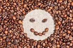 Coffee beans happy smile on burlap. Background Stock Photo