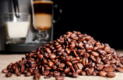 Coffee beans heap and coffee Royalty Free Stock Images