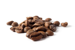 Coffee beans. Heap of coffee beans isolated on white Stock Photography