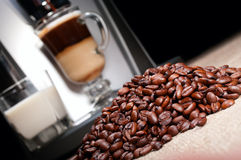 Coffee beans heap, latte and coffee Stock Image