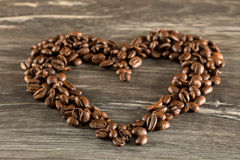 Coffee beans heart on a brownish background. A Coffee beans heart on a brownish background Stock Photography