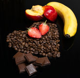 Coffee beans heart with multifruit. Food Stock Photo