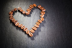 Coffee beans in heart shape Royalty Free Stock Image