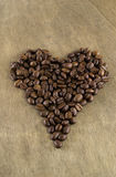Coffee beans in a heart shape Royalty Free Stock Photography
