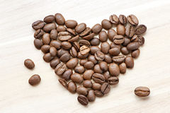 Coffee beans in heart shape Royalty Free Stock Photo