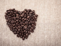Coffee Beans with heart shape on brown Royalty Free Stock Photography