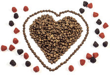 Coffee beans in heart shape with line around heart with gummy candy Royalty Free Stock Photography