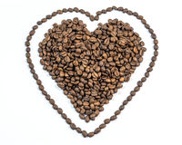 Coffee beans in heart shape with line around heart on white background Royalty Free Stock Photos