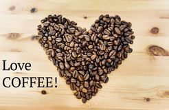 Coffee Beans in Heart Shape and Love Coffee Text Royalty Free Stock Photography