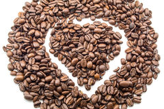 Coffee beans in a heart shape texture background close isolated on white Stock Photography