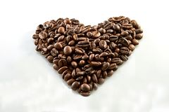 Coffee beans in heart shape white background stock image