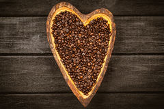 Coffee beans in a heart shaped bowl Stock Photo