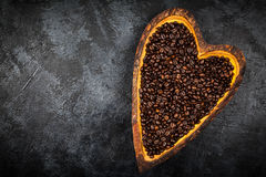 Coffee beans in a heart shaped bowl Royalty Free Stock Photography
