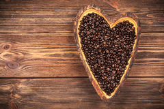 Coffee beans in a heart shaped bowl Royalty Free Stock Photos