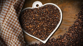 Coffee Beans in a Heart Shaped Bowl Stock Images