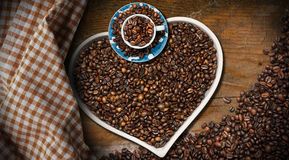 Coffee Beans in a Heart Shaped Bowl Royalty Free Stock Photo