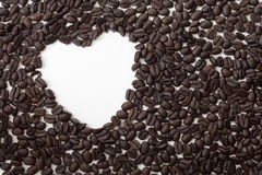 Coffee beans with heart-shaped hole Stock Images