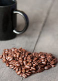 Coffee beans heart. Some coffee beans on a board like a heart Royalty Free Stock Image