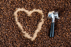 Coffee beans. Heart in coffee beans withporta filter Stock Image