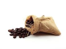 Coffee beans in hemp sack bag isolated on white background Stock Photography