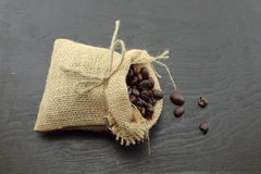 Coffee beans in hemp sack bag  on wood background Stock Photo