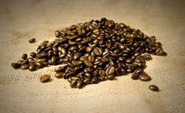 Coffee beans on hessian Royalty Free Stock Photography