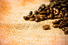 Coffee beans on hessian Royalty Free Stock Images